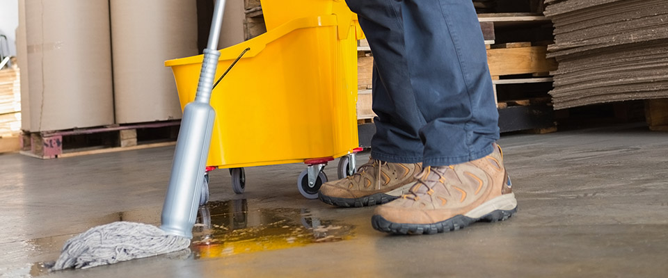 man mopping warehouse floor